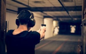 man aiming in a gun range