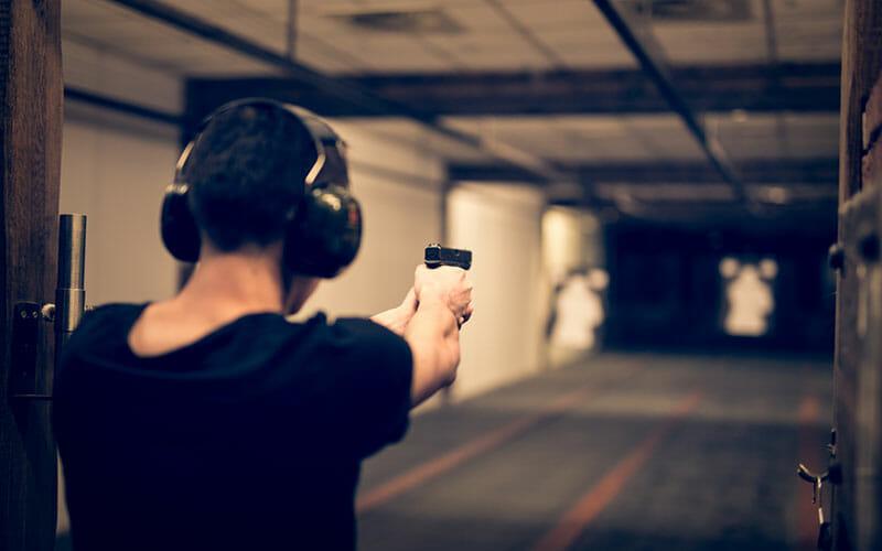 man aiming in a gun range